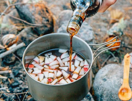 This warm apple, maple & rum cocktail is perfect for sipping around a campfire.