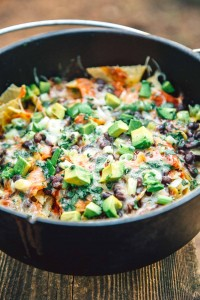 Campfire Nachos made in a Dutch oven are a simple, fast, and easy camping meal that the whole family will enjoy.