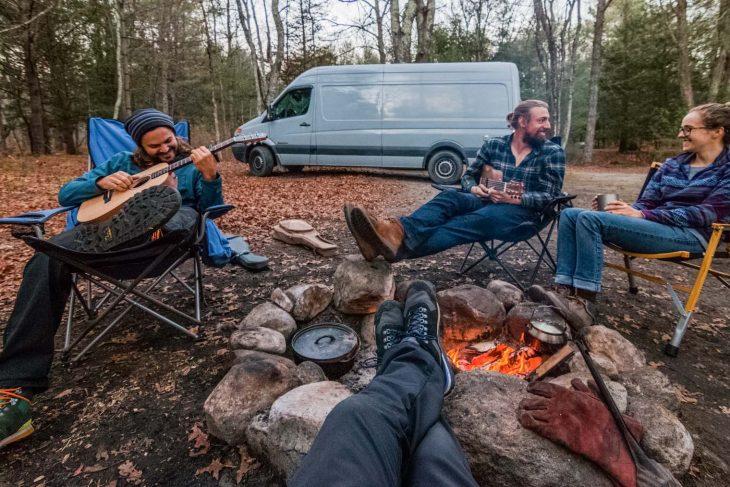 Friends sitting around a campfire