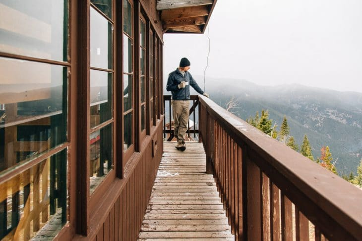 Michael standing on the deck of the Garnet mountain fire lookout tower