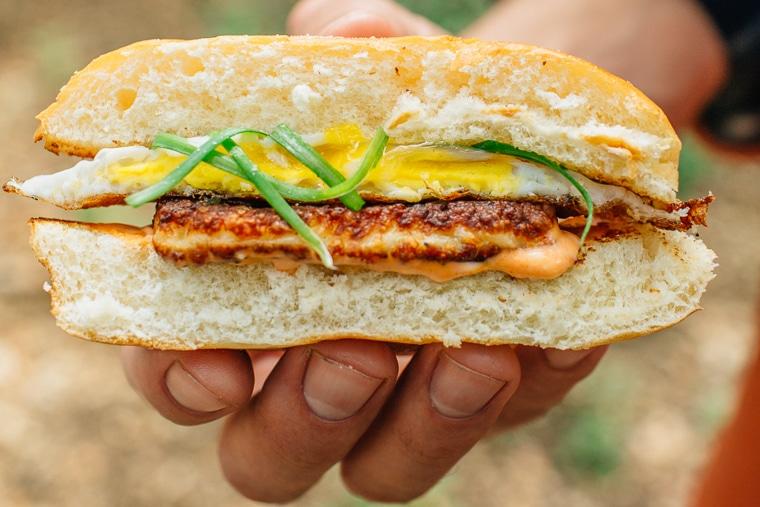 Holding a Halloumi Breakfast Sandwich