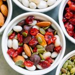 Trail mix and ingredients in white ramekins