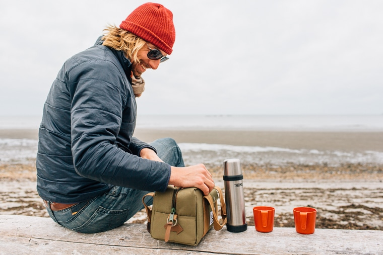 Michael at the beach with a thermos and two red cups