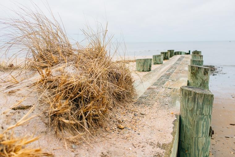 a sandy pier at a beach