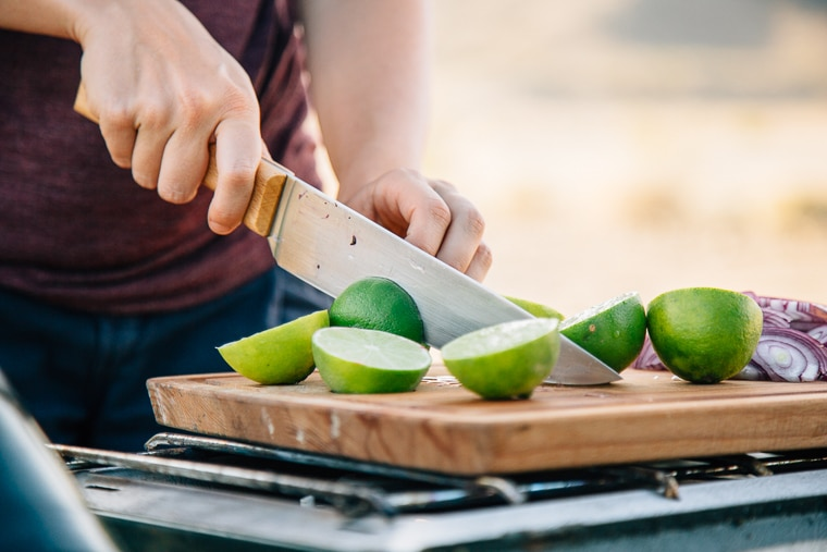 Megan cutting limes on a cutting board