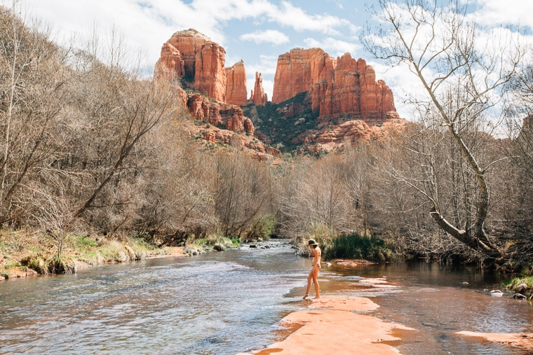 Megan putting her foot in the water at red rock Creek