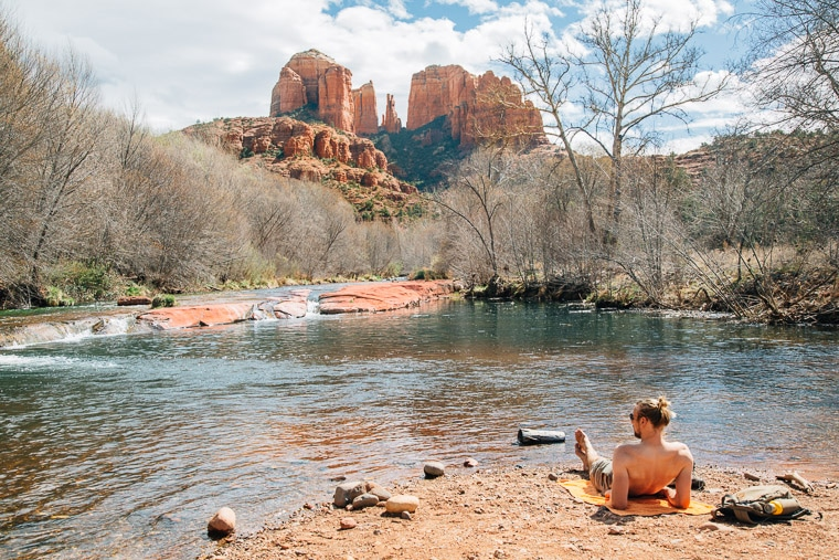 Michael relaxing on a rock next to the red rock creek swimming hole