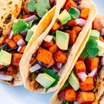These #vegan Sweet Potato Tacos with smoky black beans are super simple to prepare over the fire on your next camping trip.