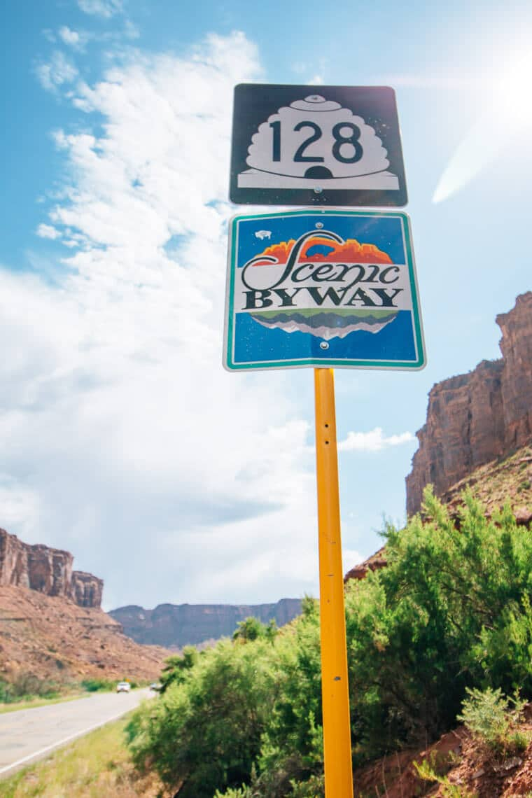 A road sign for the 128 scenic byway