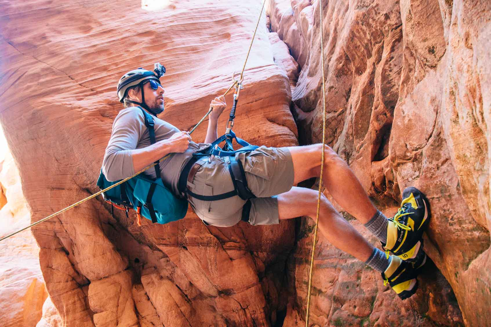 Michael repelling into a slot canyon
