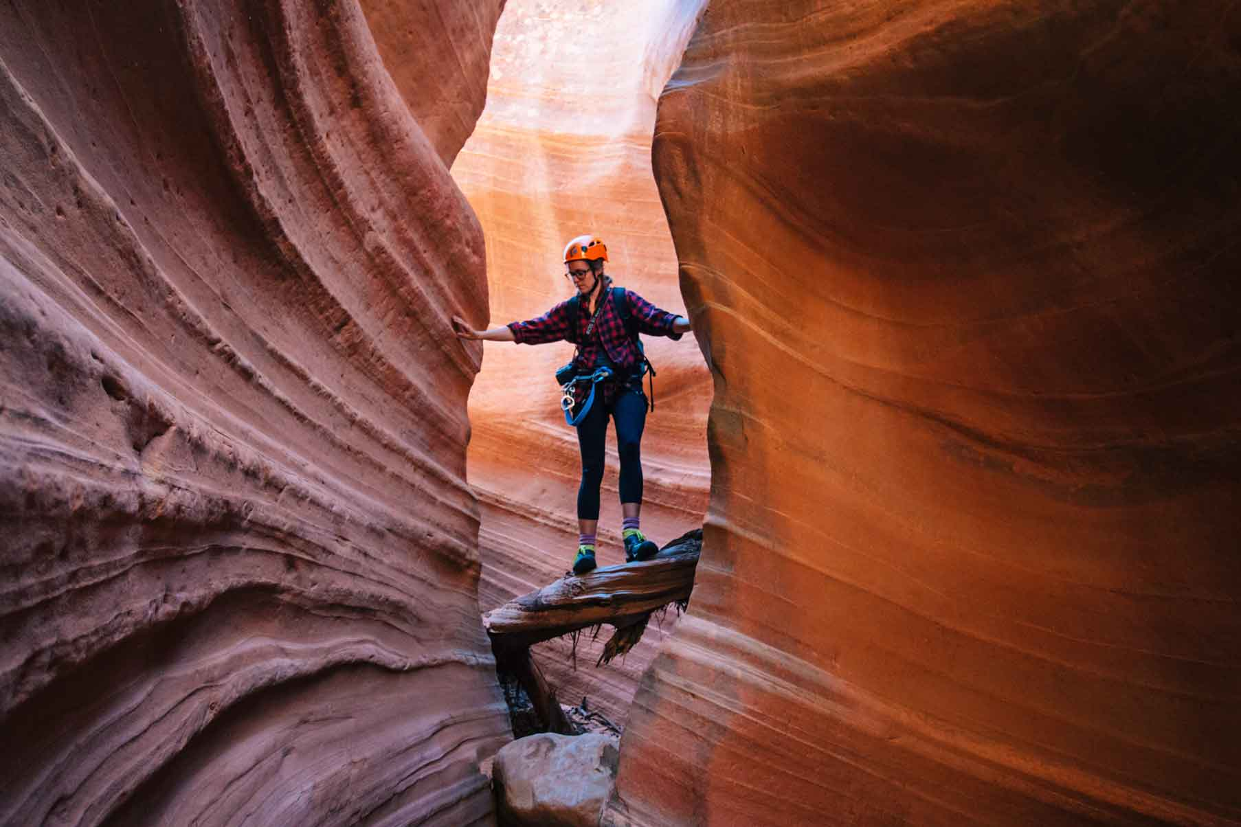 Megan standing on a rock in a slot canyon