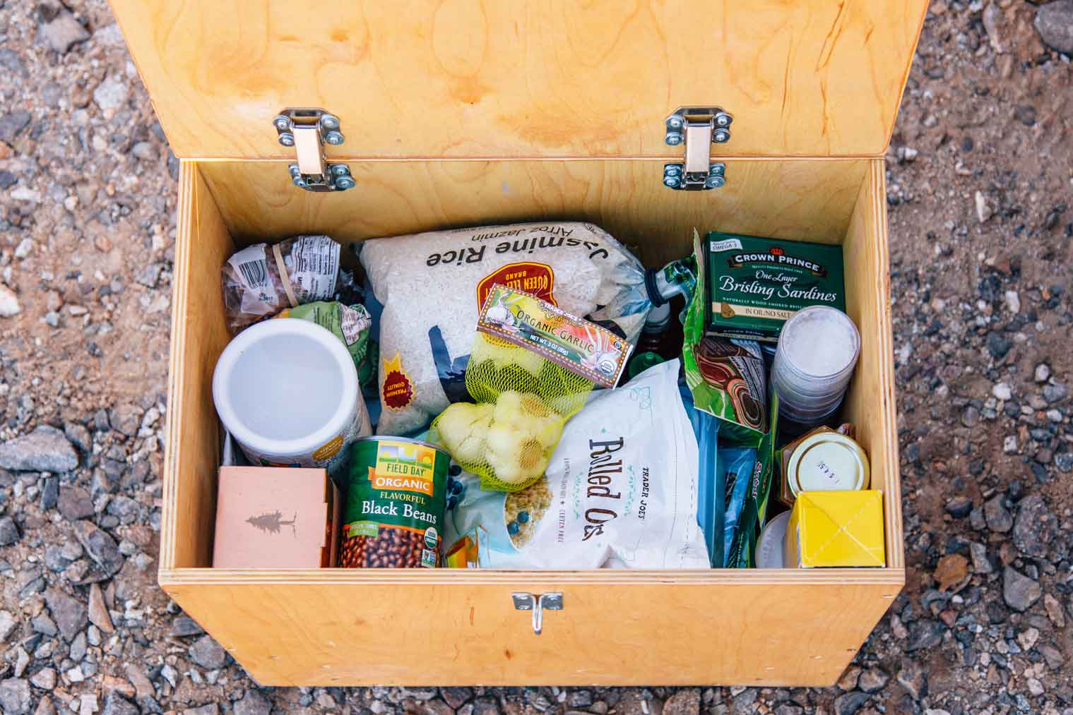 Wooden crate full of camping pantry ingredients