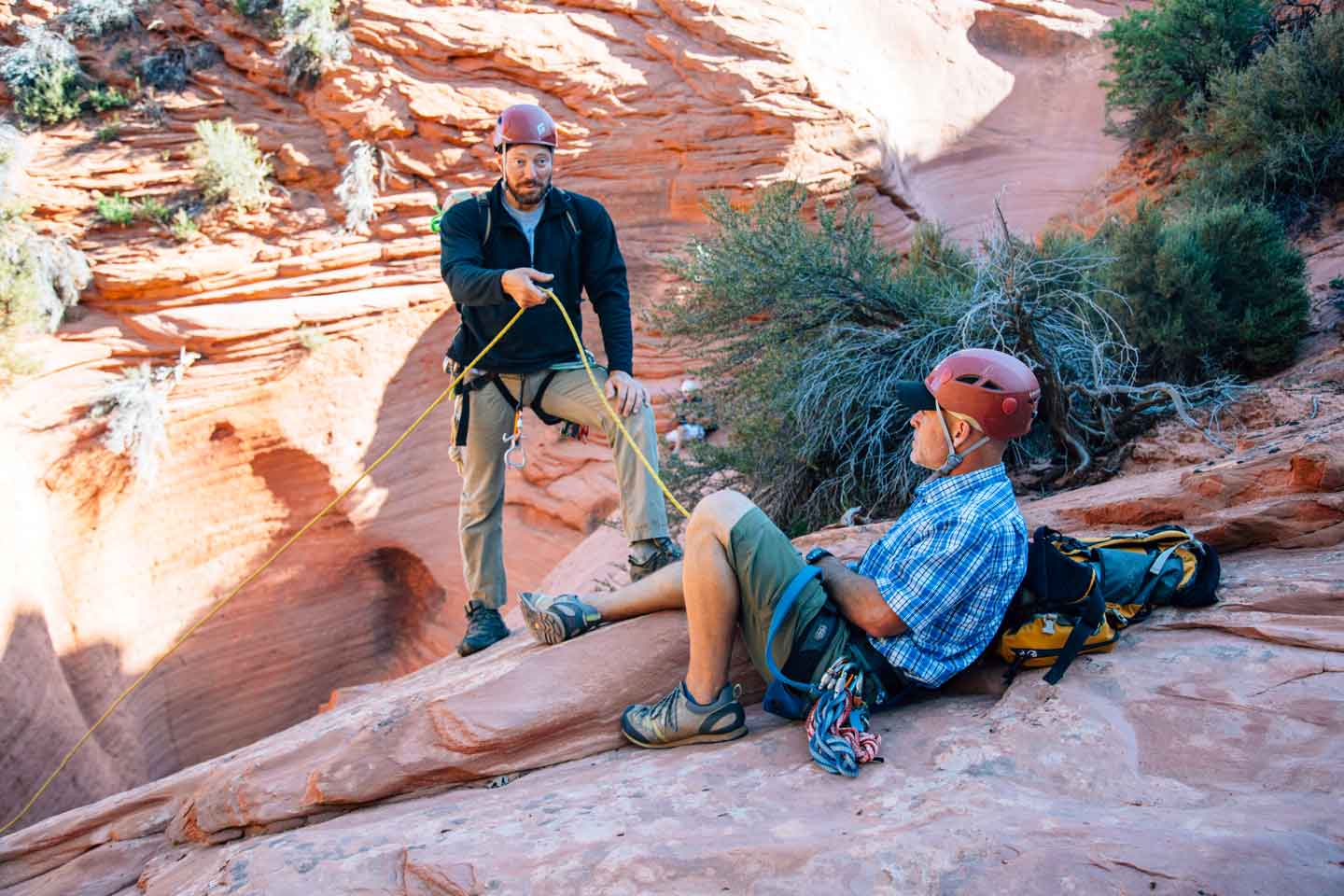 A guide demonstrating how to use ropes to repel into a slot canyon