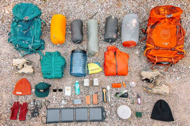 Backpacking gear laid out on the ground