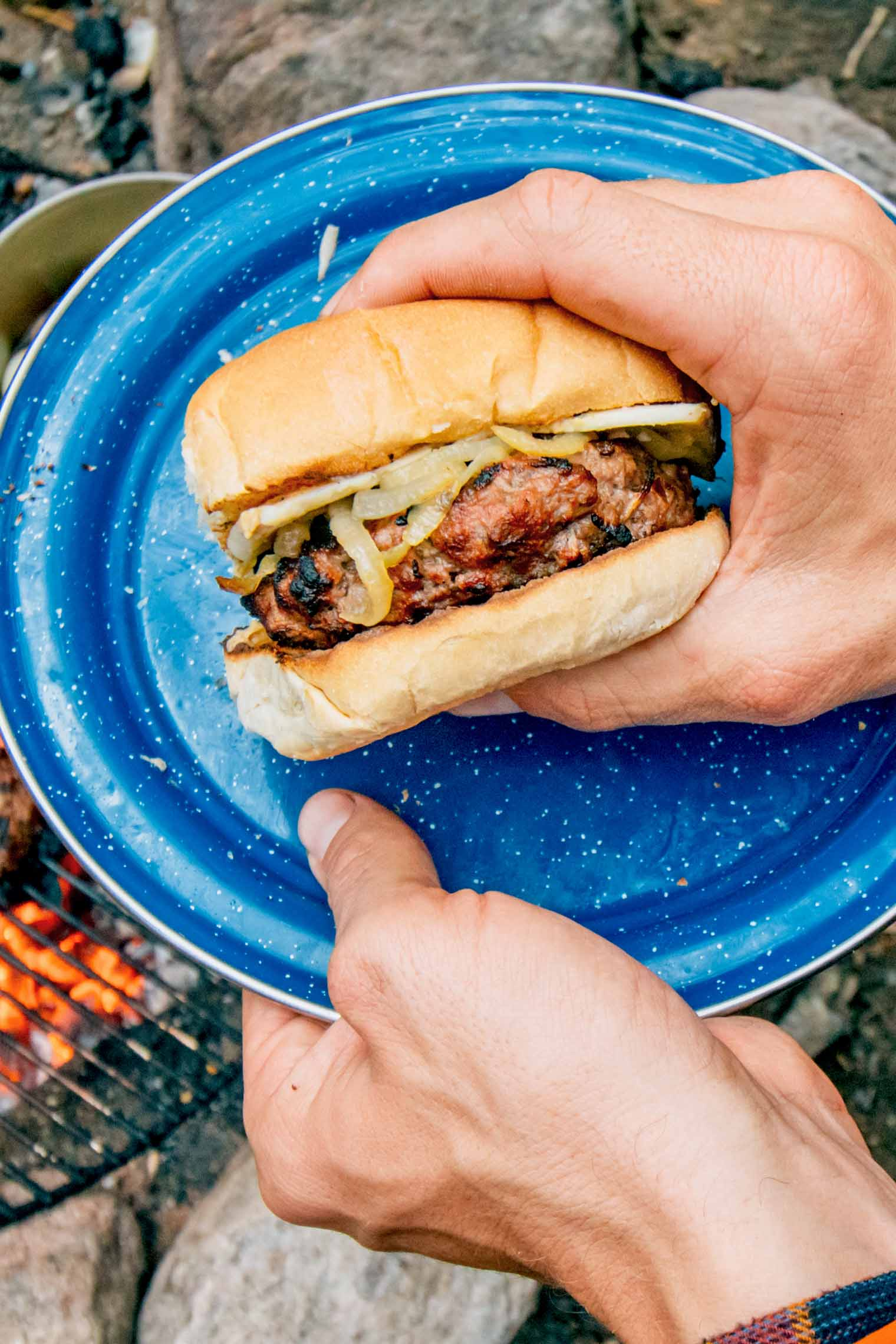 Grilled apple cheddar burgers with caramelized onions - perfect for your next camping trip or backyard BBQ!