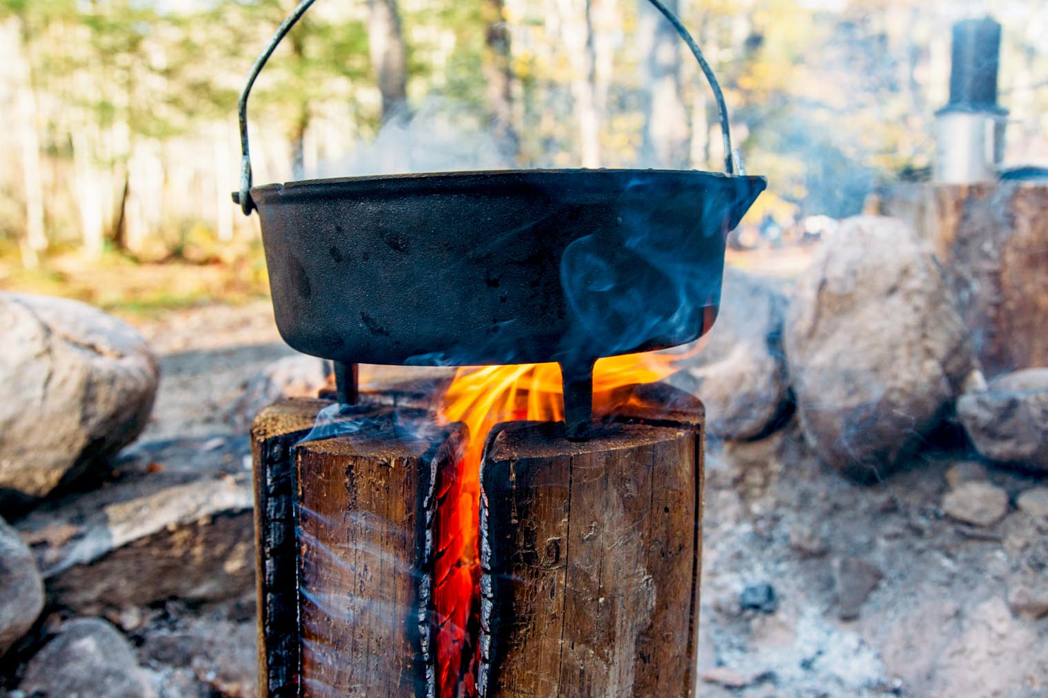 A Dutch oven sitting on the top of a Swedish firelog