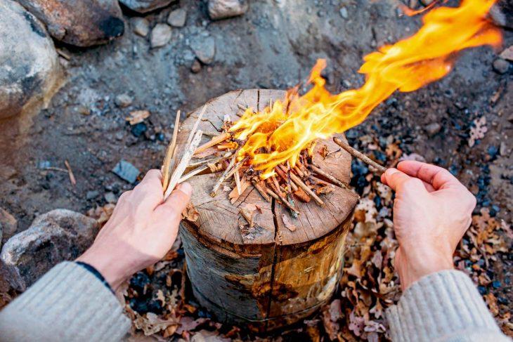 Michael adding kindling to a Swedish firelog