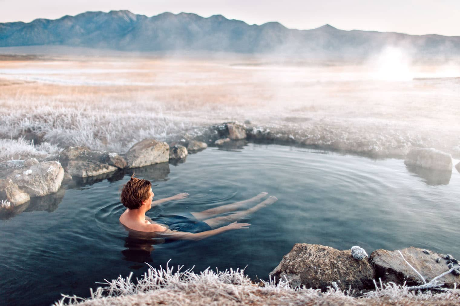 Michael sitting in a hot spring