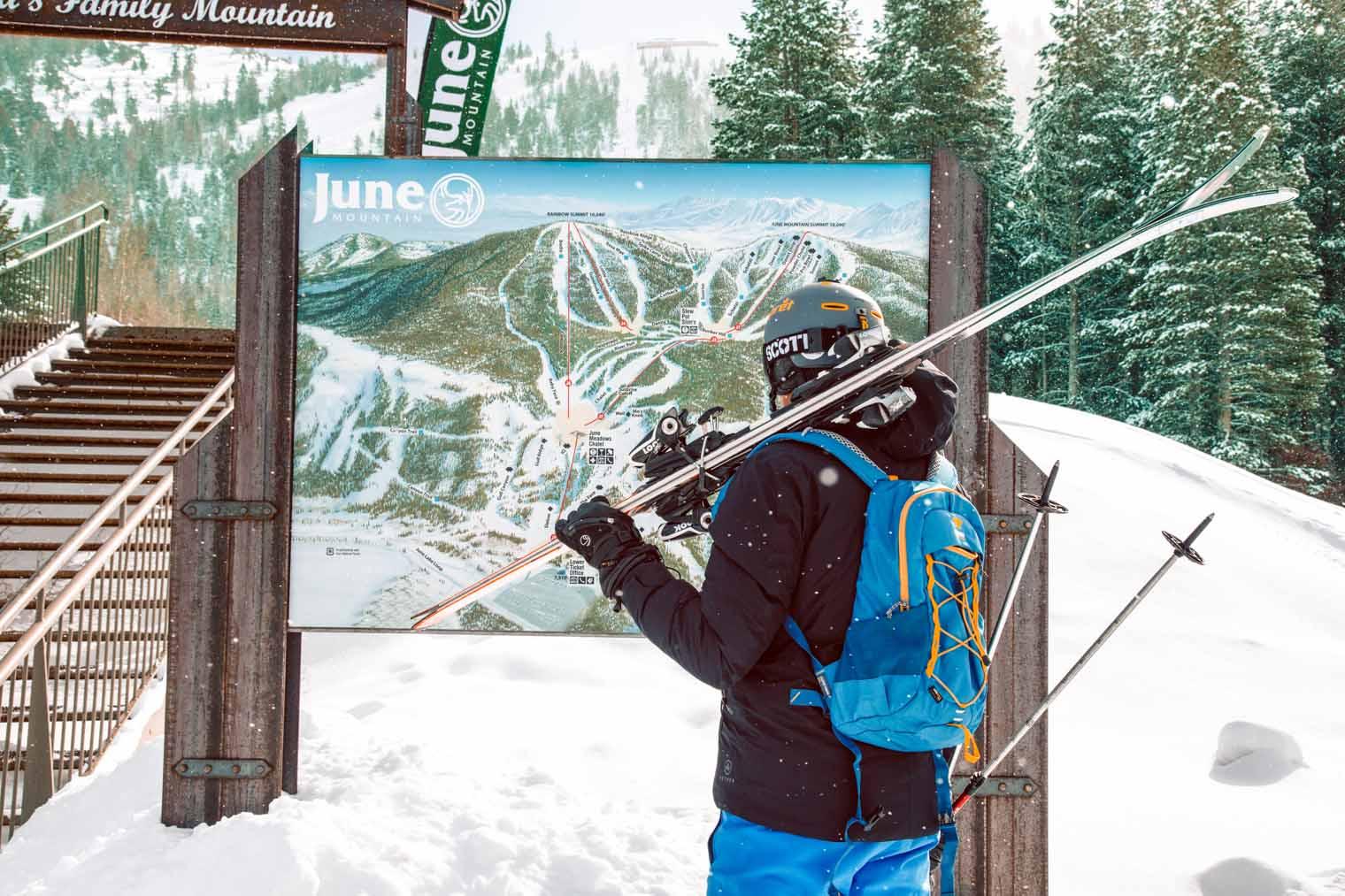 Megan looking at a map of ski hill