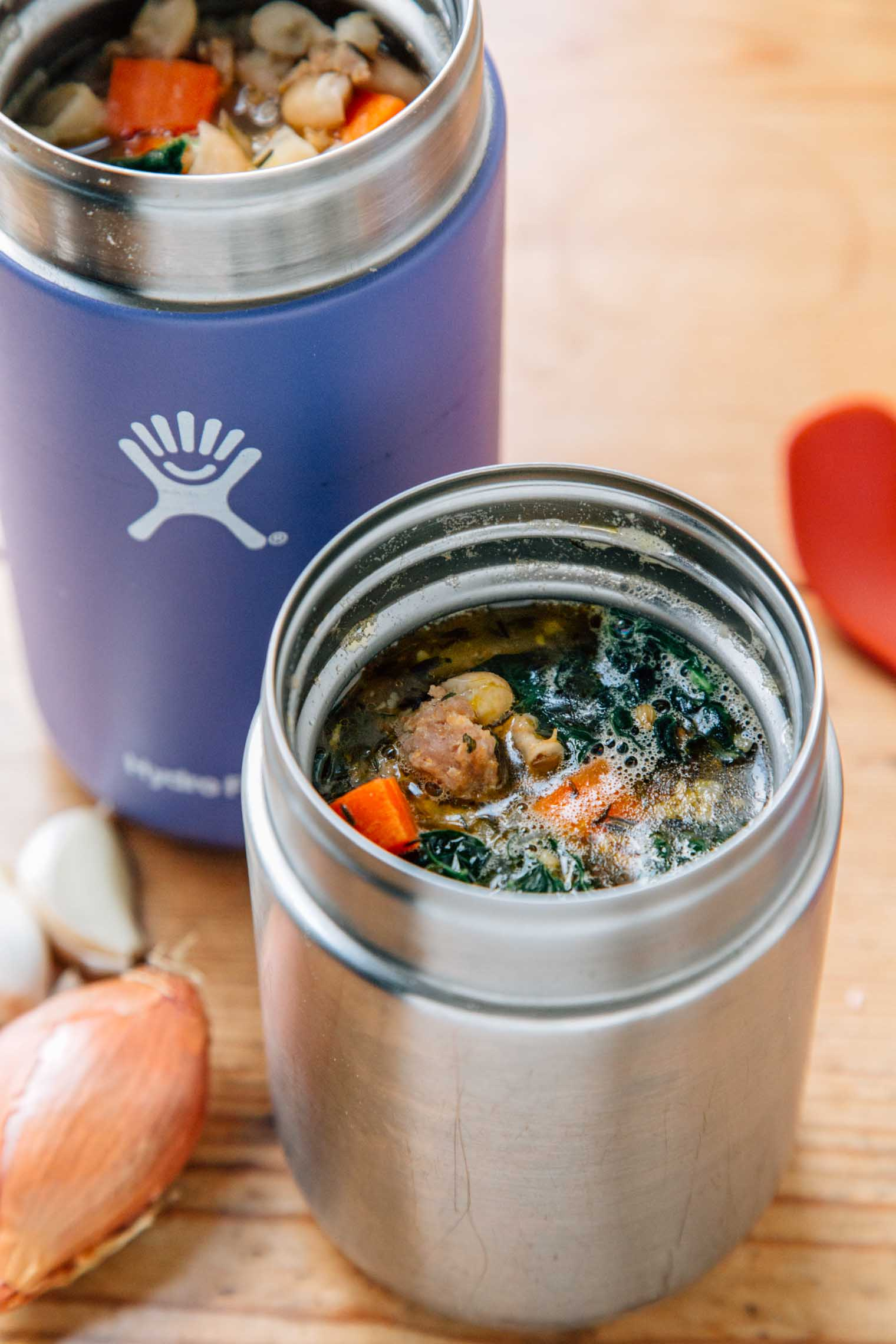 Sausage and bean soup in an insulated container