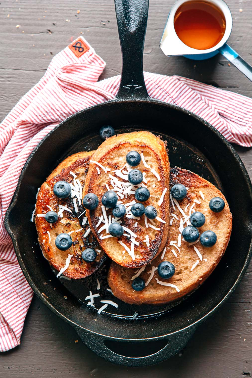 Three slices of French toast in a skillet