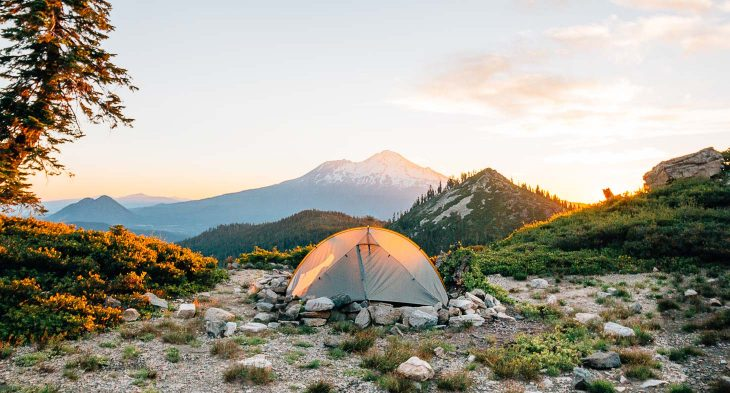 A backpacking tent with a mountain in the background