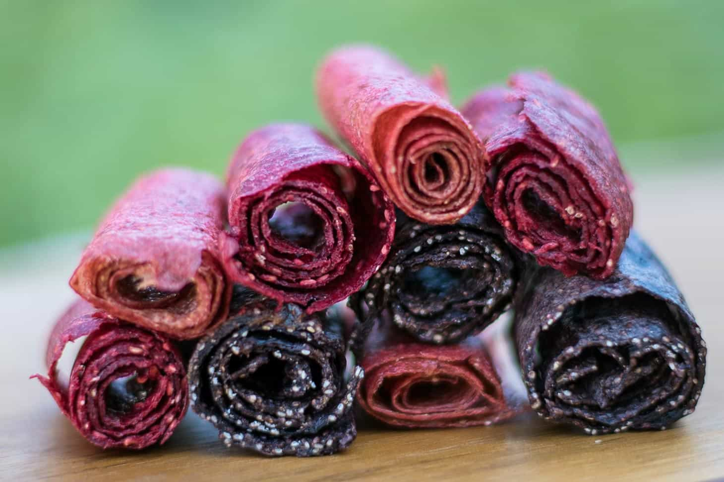 Fruit leathers rolled up and stacked in a pile