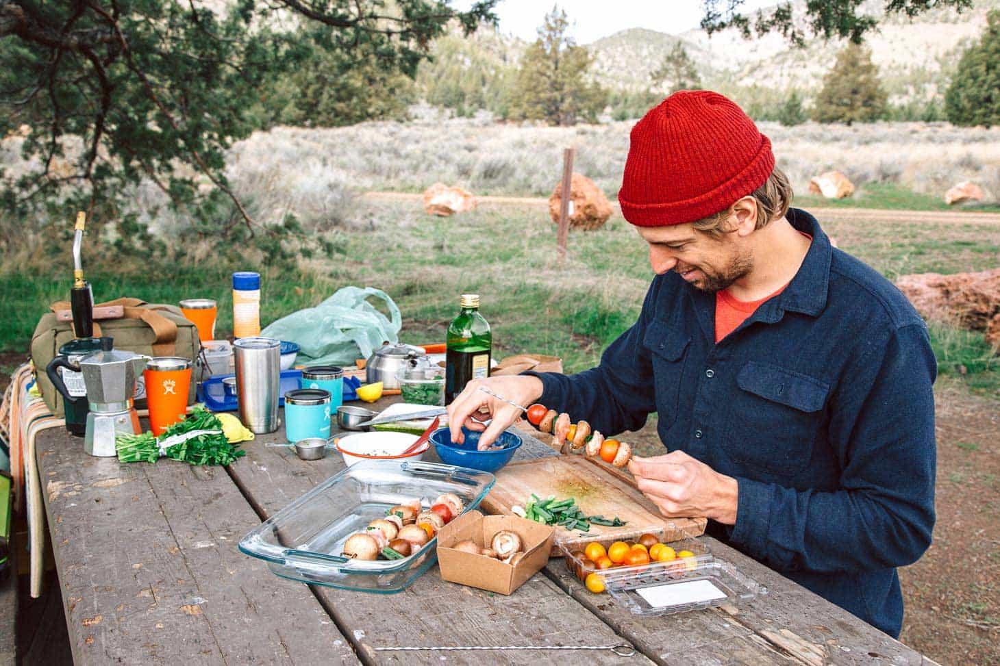Michael threading ingredients onto skewers