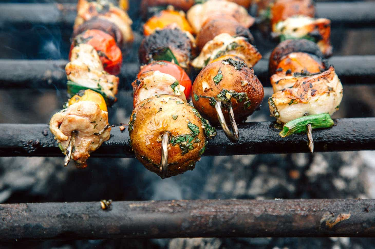 Chicken and veggie kabobs on a grill