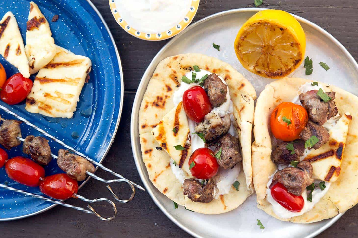 Grilled Gyros Kebabs on a silver camping plate.
