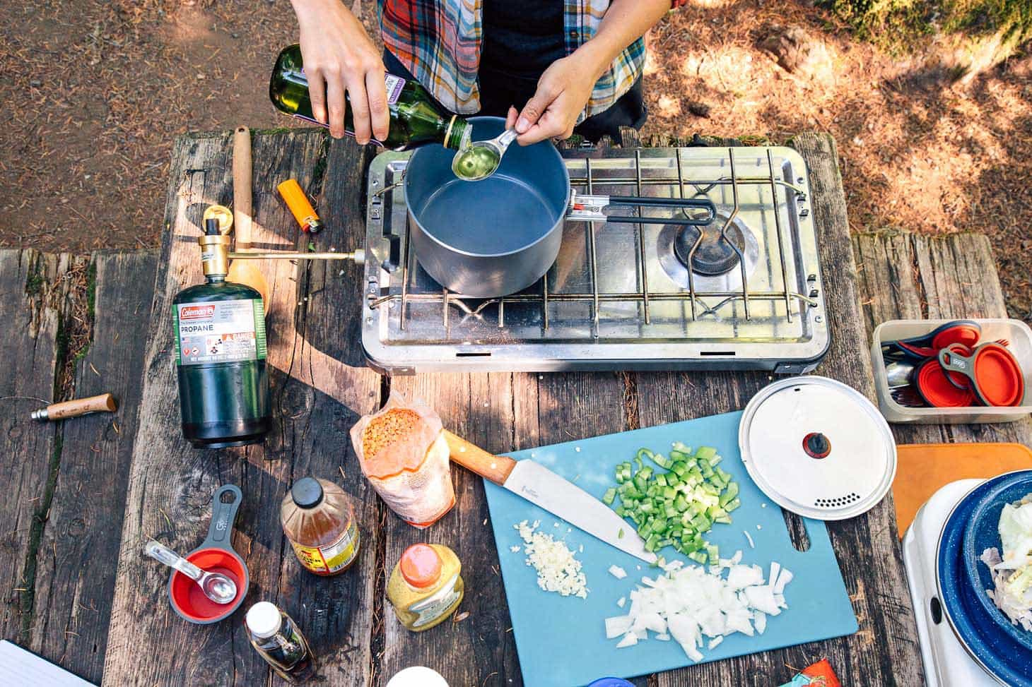 Red lentil sloppy joes ingredients spread out on a camping table
