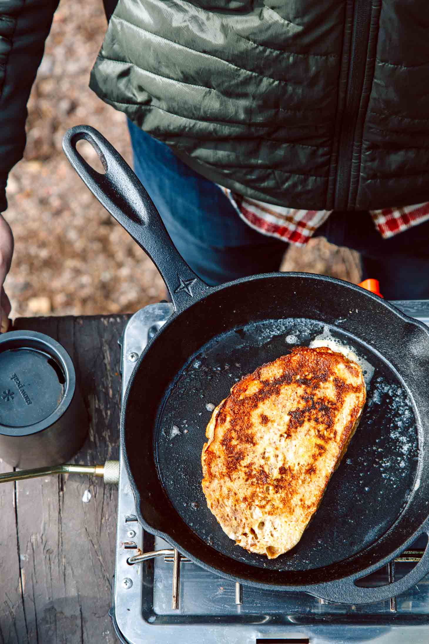 French Toast in a cast iron skillet on a camping stove.