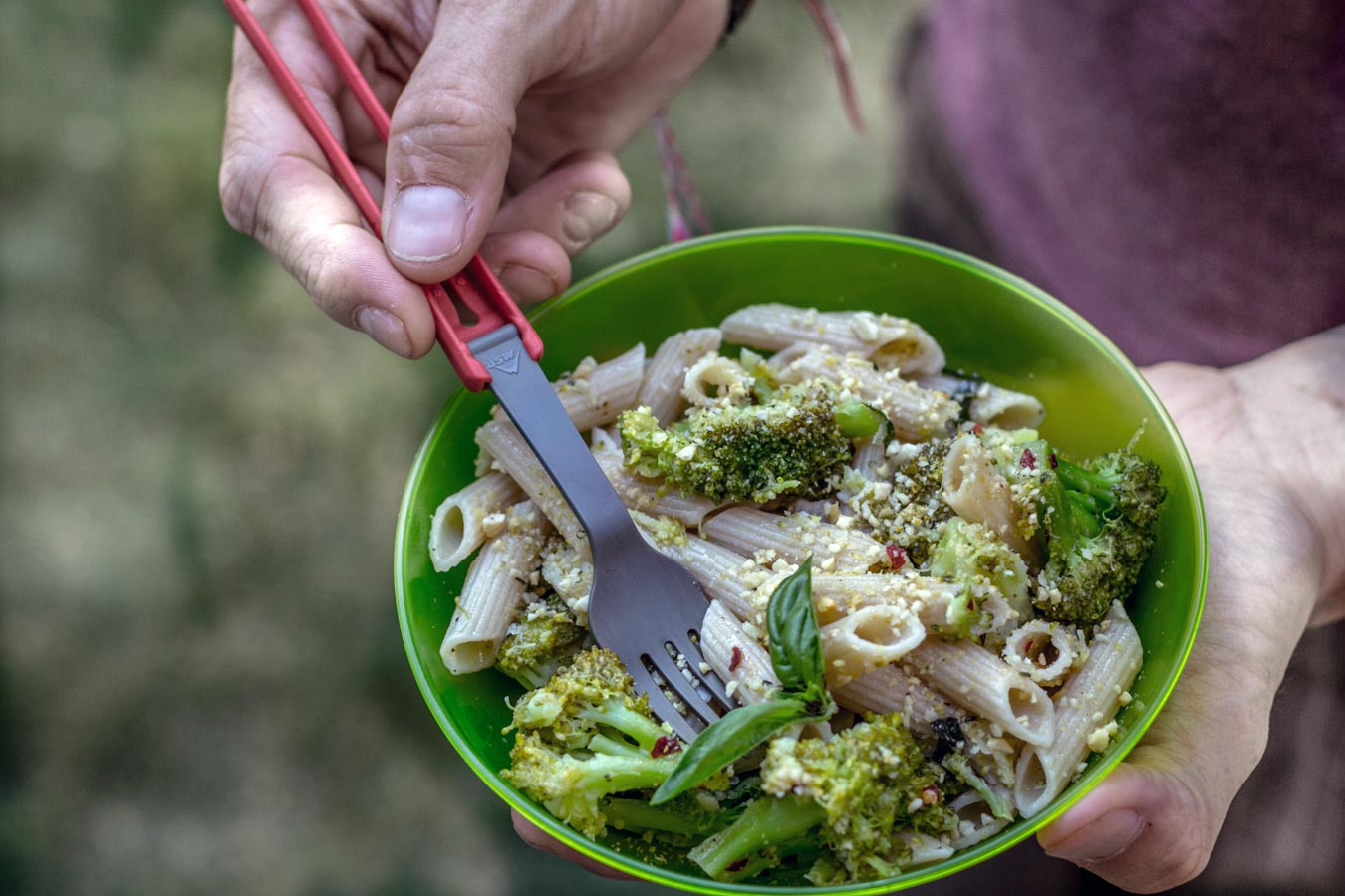 Lemon Broccoli Pasta in a green camping bowl.