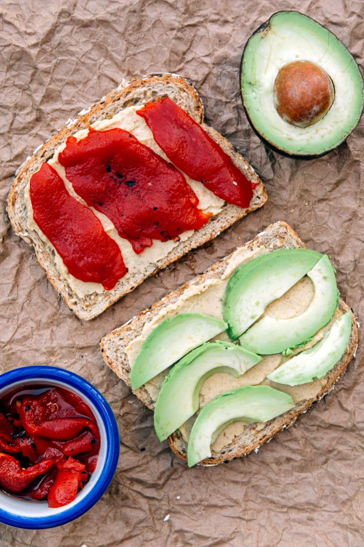 Hummus, avocado, and pepper sandwich