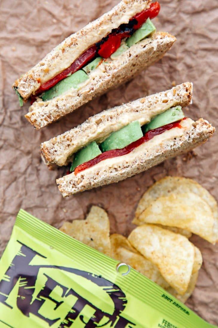 Hummus, avocado, and pepper sandwich