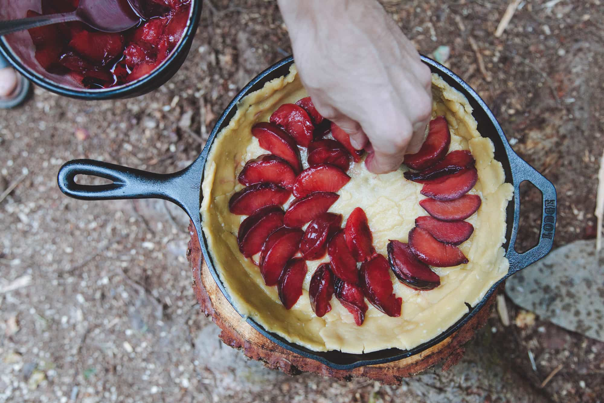 Building a plum tart in a cast iron skillet.