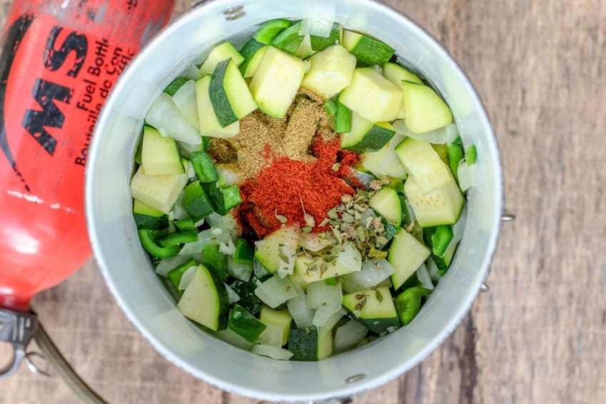 Chopped vegetables and spices in a bowl