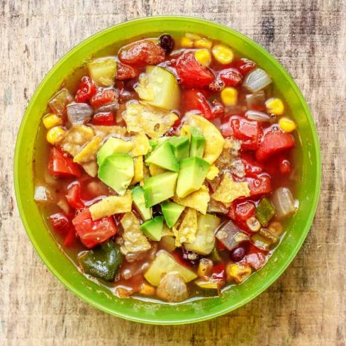Tortilla soup in a green camp bowl