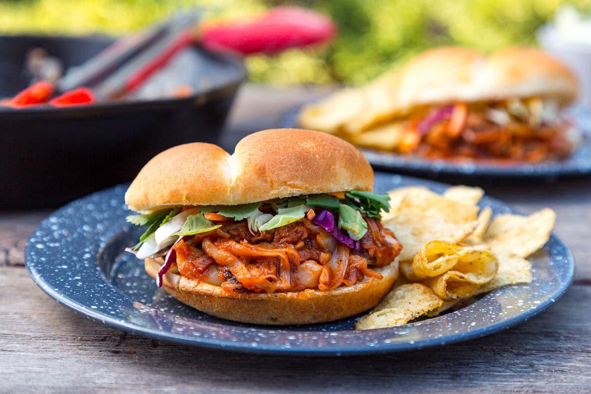 A BBQ Jackfruit Sandwich on a camping plate