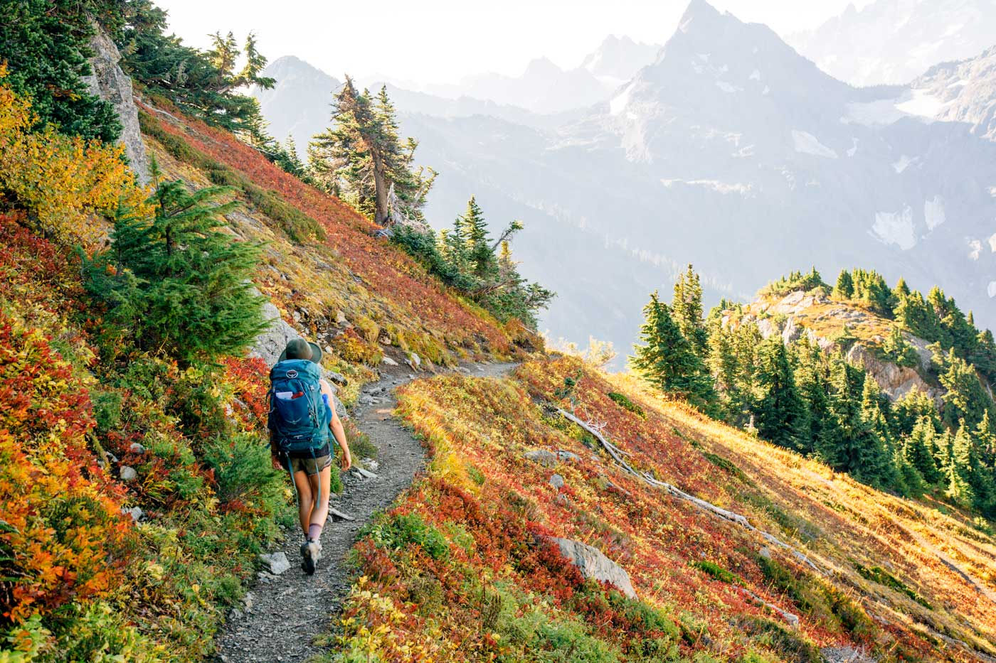 Woman hiking in the Cascade Mountains with fall foliage