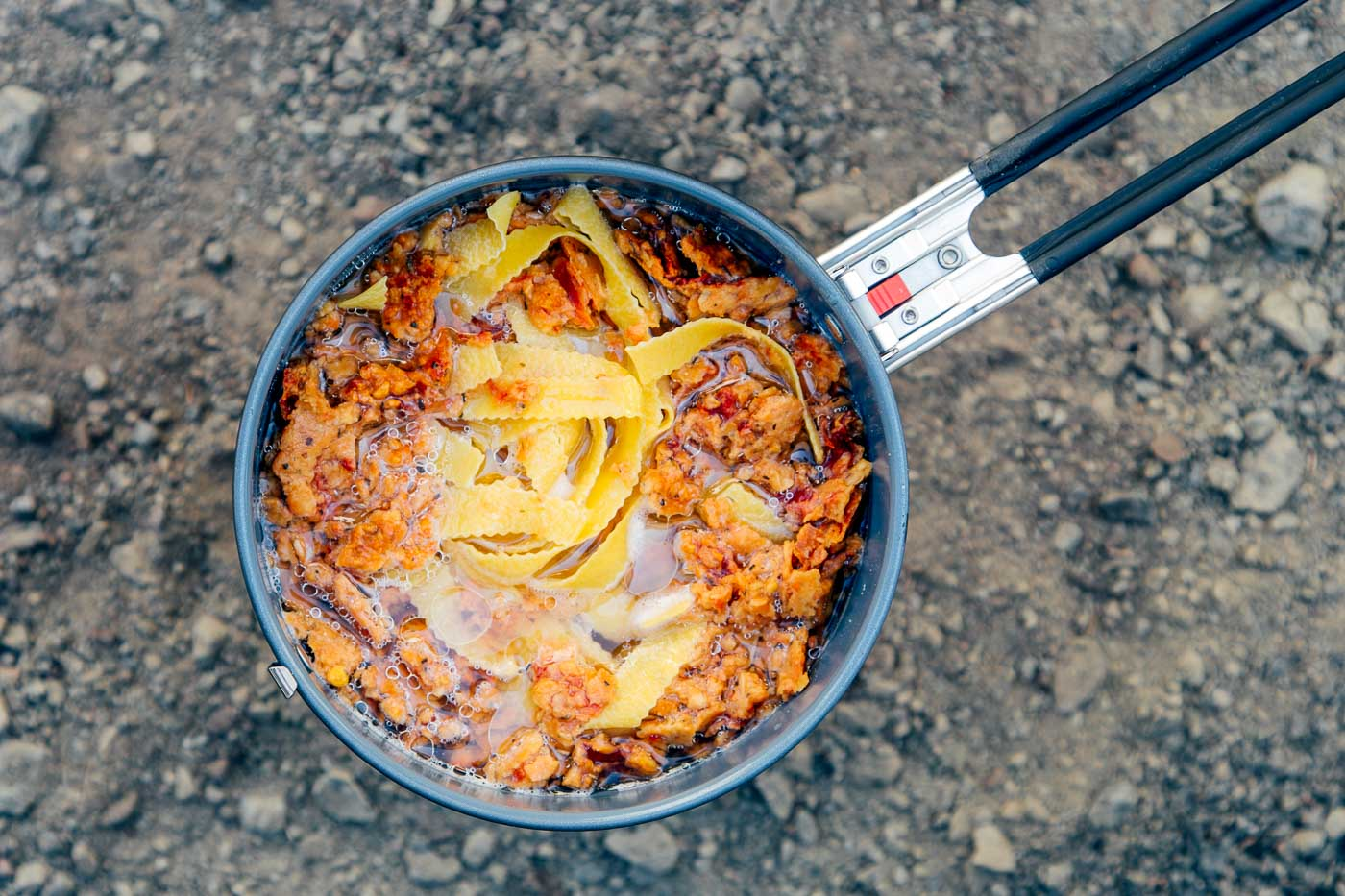 Red lentil marinara and pasta in a backpacking pot