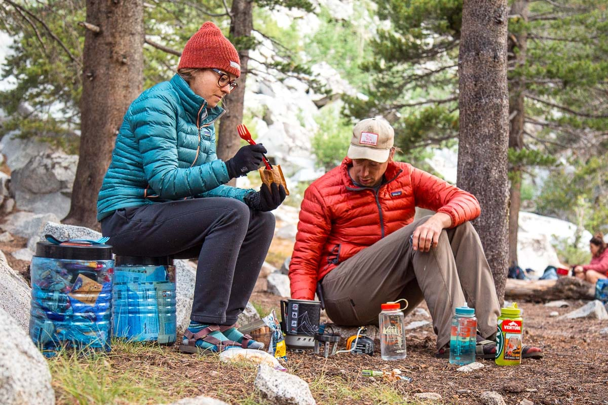 Megan and Michael eating oatmeal at a backpacking campground
