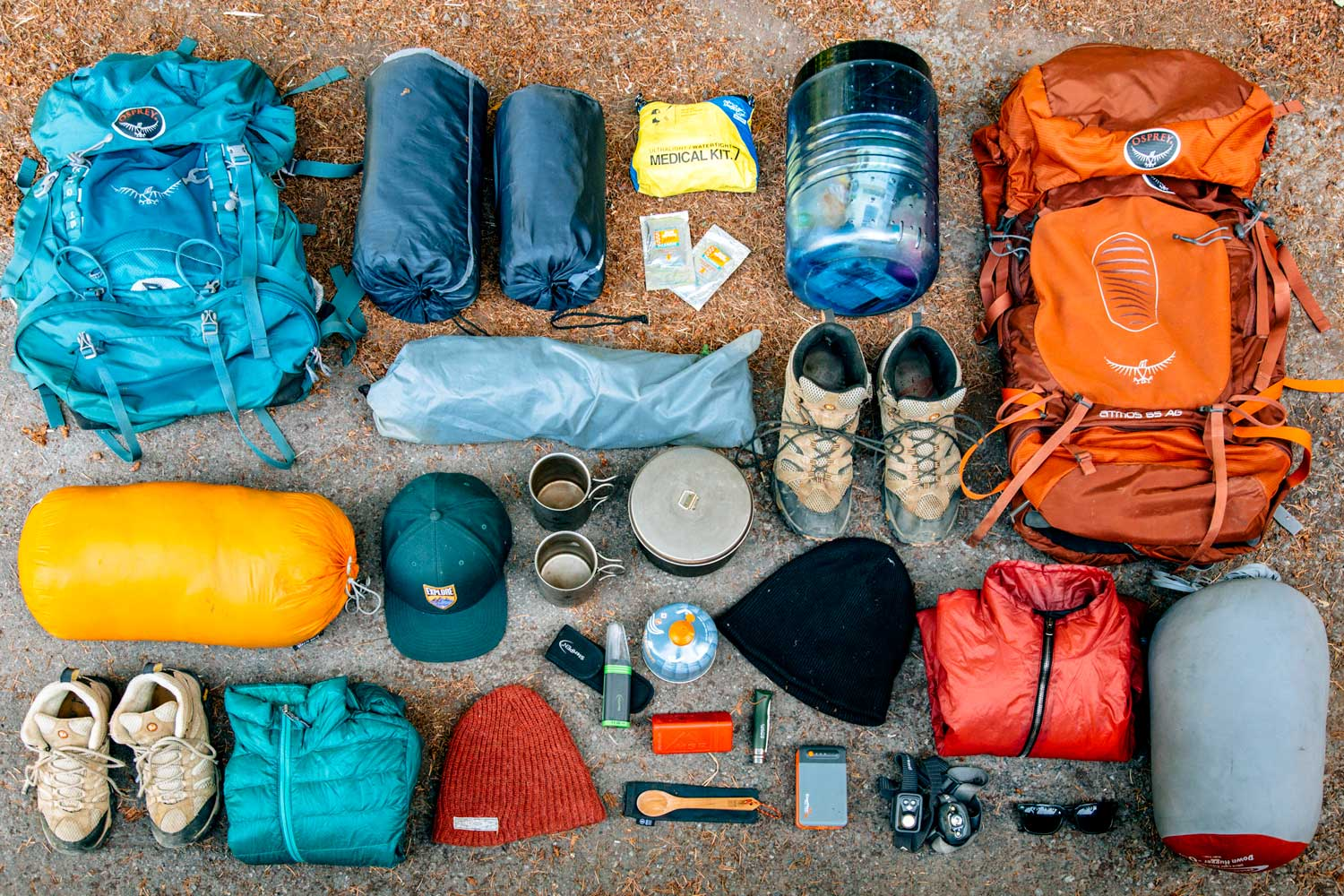 Overhead view of backpacking gear laid out on the floor.