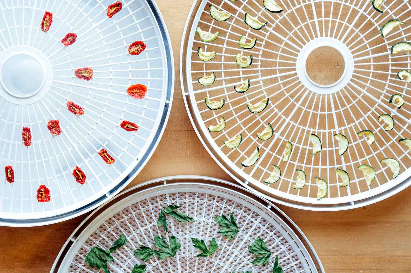 Dehydrator trays with dried vegetables