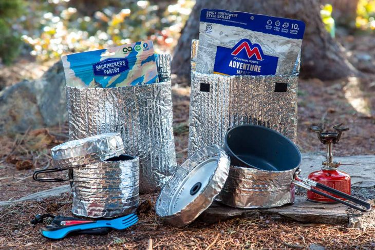 A variety of pots and backpacking pot cozy options