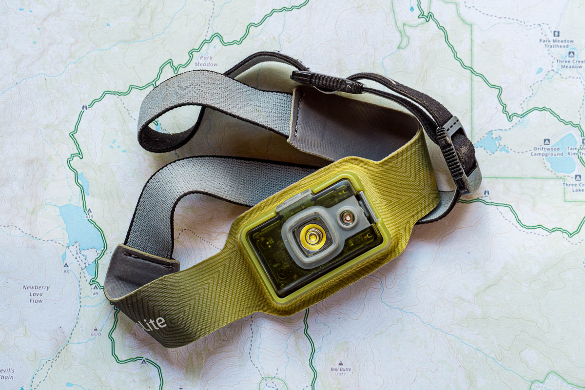 A green headlamp displayed on a trail map