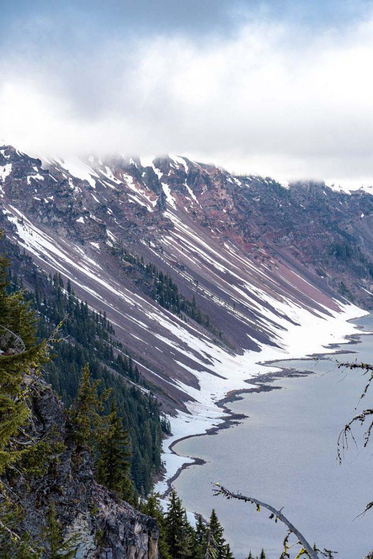 The shoreline of Crater Lake where it meets the caldera walls.