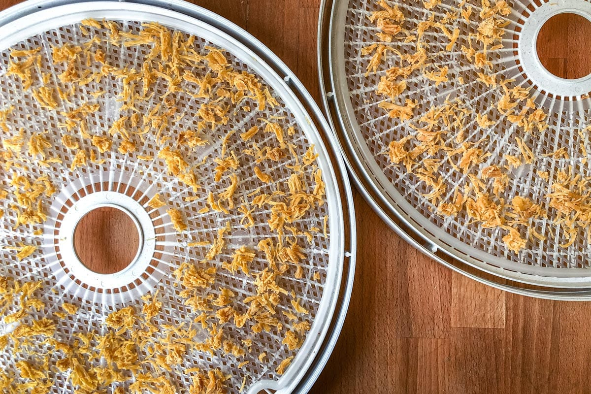 Dehydrated chicken on trays