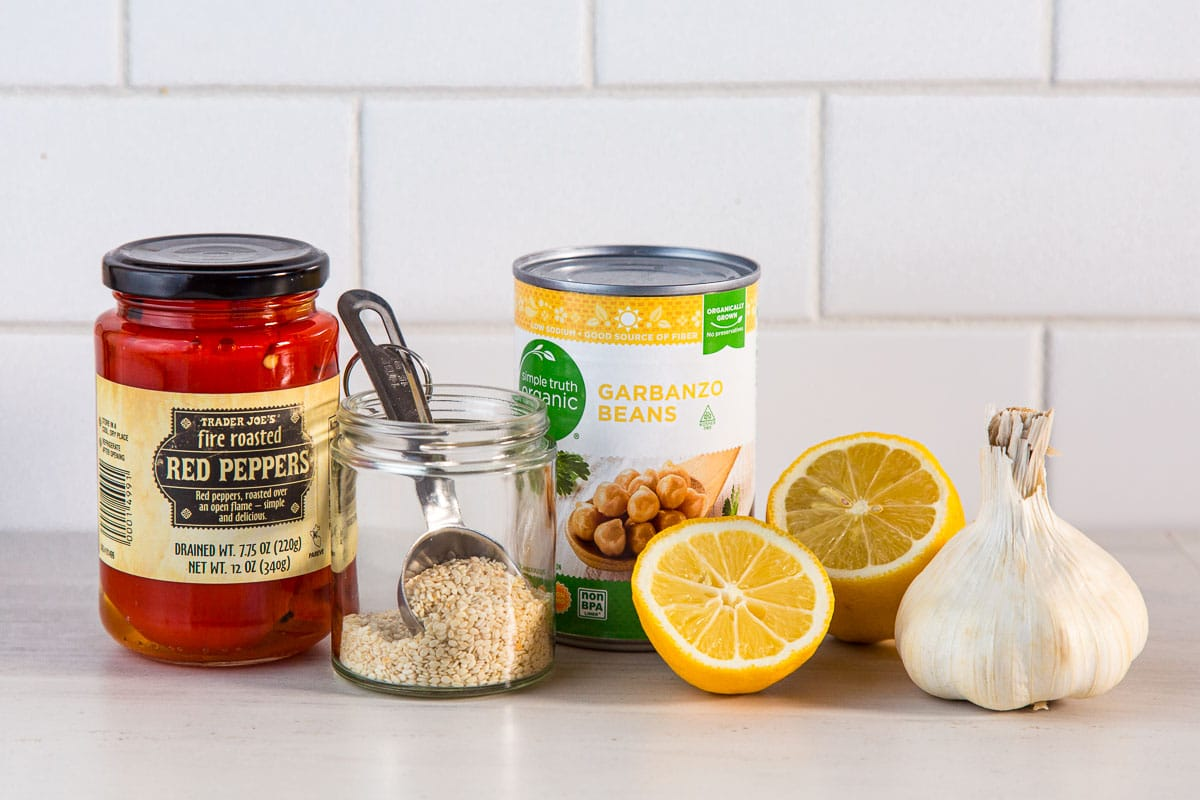 Ingredients for dehydrated hummus: roasted red peppers, sesame seeds, canned garbanzo beans, lemon, garlic