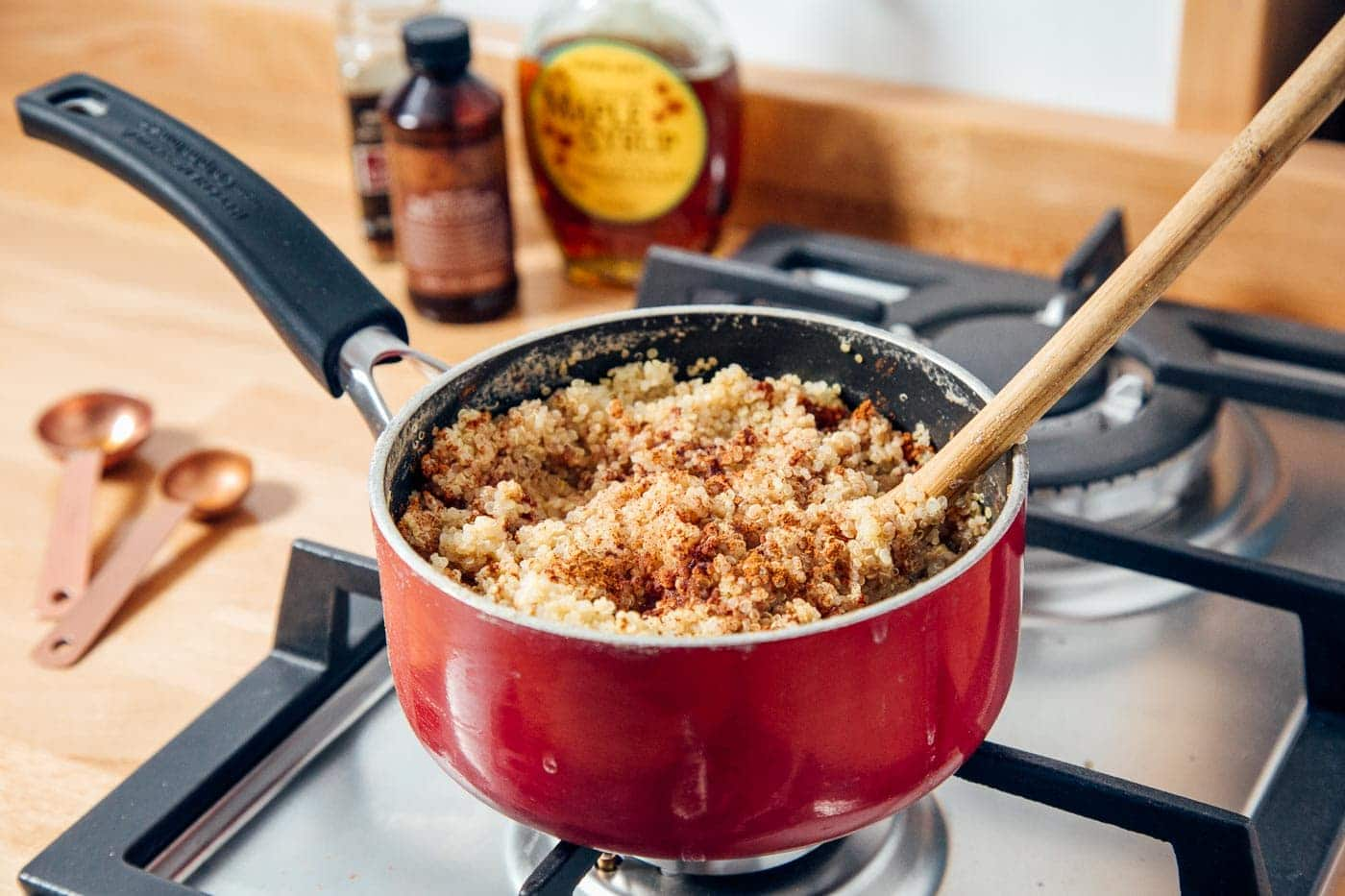 Quinoa cooking in a pot on a stove